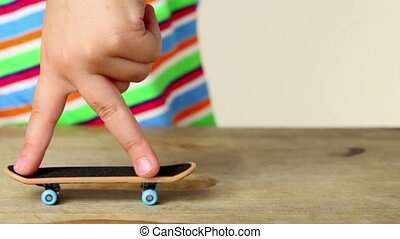 Two fingers on fingerboard trying to do simple trick