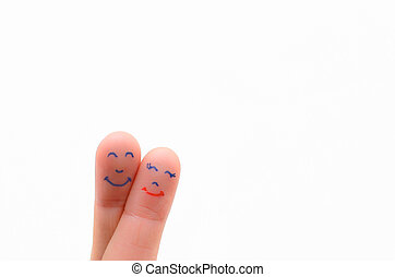 two fingers with man and women face
