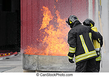 two firefighters with oxygen bottles off the fire