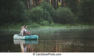 Two fisher going in for a hobby, spending leisure time on...