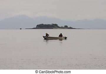 Two Fisherman on Foggy Alaska Waterway - Two fisherman in a...