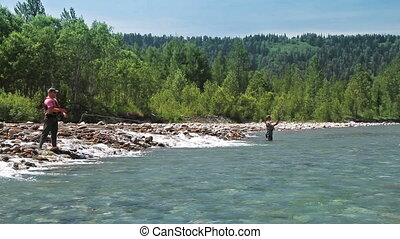 Two fishermen - Casting fly fishing at a mountain river