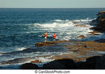 Two fishermen fishing in the bay