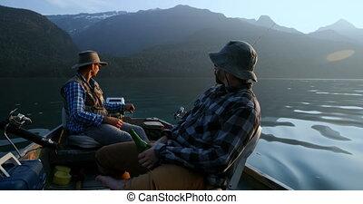 Two fishermen fishing in the river 4k