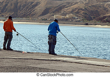 two fishermen in the wharf