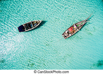 two fishing boats among clear ocean water
