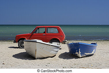 fishing boats - Two fishing boats and car standing on the ...