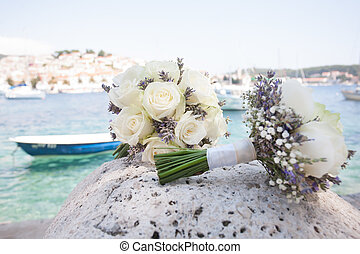 Two flower bouquets and a boat