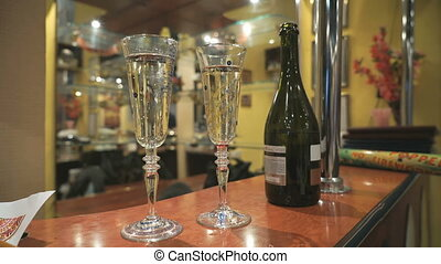 Two Flutes with Sparkling Wine over Holiday. Couple of...