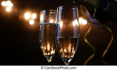 Two Flutes with Sparkling Wine over Holiday Bokeh Blinking...