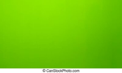 Two football players face helmets on the field. Green screen. Close up