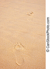 two footprints in the sand, vertical shot