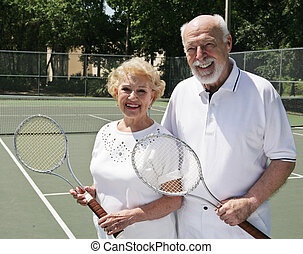 Two For Tennis - An active, happy senior couple on the...