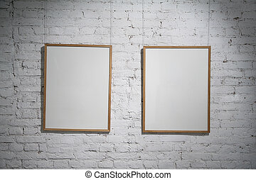 two frame on brick wall