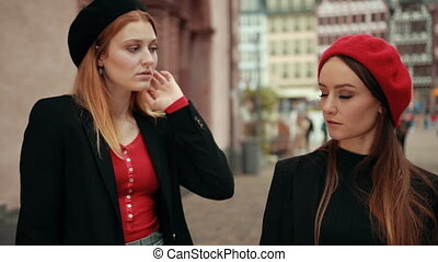 Two French women compete evaluating each other, but begin to...