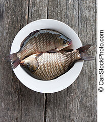 Two fresh carps in a plate