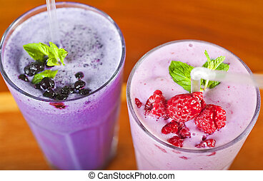 Blueberry and a raspberry fresh fruit fruit smoothie
