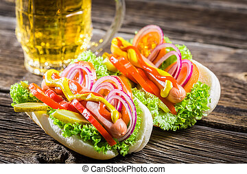 Two fresh homemade hot dog with beer