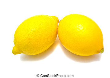 Two fresh lemons on white