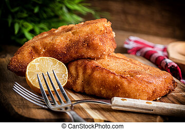 Two fried cod fillet pieces.