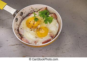 Two fried eggs in a frying pan