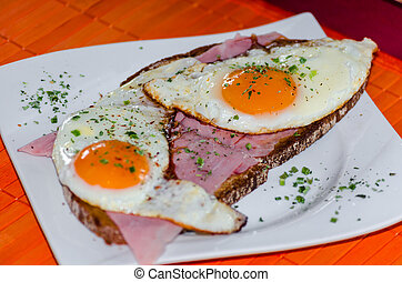 Two fried eggs on bread