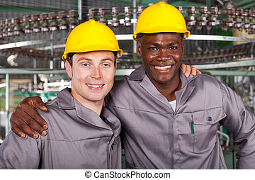 friendly industrial workers colleagues - two friendly...