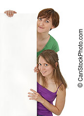 Two friendly young women holding a blank banner ad