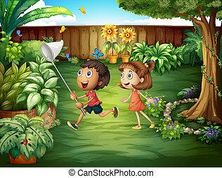 Two friends catching butterflies at the backyard -...