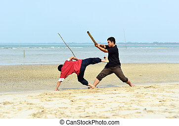 Two friends fighting near the beach