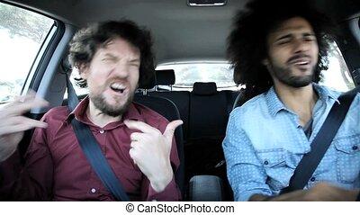 Two friends in car happy