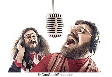 Two friends singing a karaoke - Two funny friends singing a...