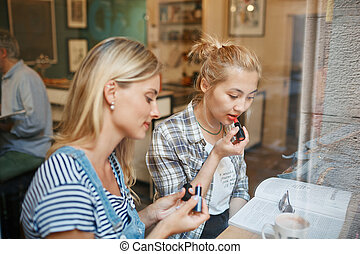 Two friends sit inside cafe met to discuss business, drink coffe