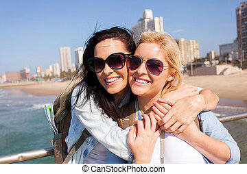 two friends touring Durban, south africa - two happy friends...