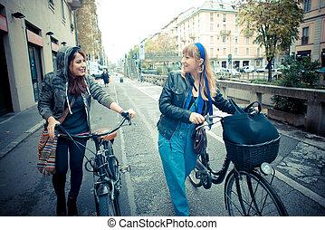 two friends woman on bike in urban contest