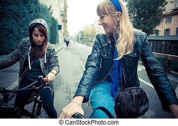 two friends woman on bike