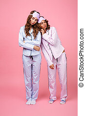 Two friends women in pajamas sleeping.