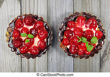 two fruit tart on wooden background