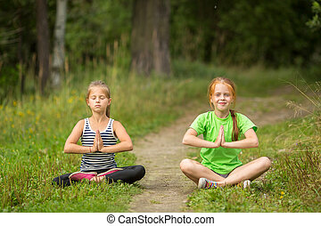 Two fun little girls sitting