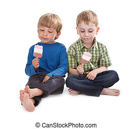 two funny boys eating ice lolly