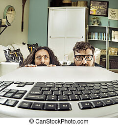 Two funny computer scientits staring at a keybord - Two...