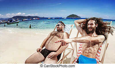 Two funny friends taking a sunbath - Two funny geek friends ...