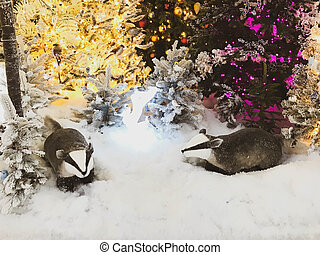 two funny raccoons are sitting under a tree on new year's eve. decorations for the shopping center and shop windows. cute decoration for buyers. cute handmade decoration