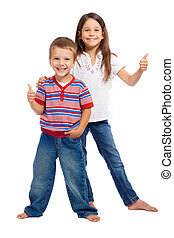 Two funny smiling little children with thumbs up sign