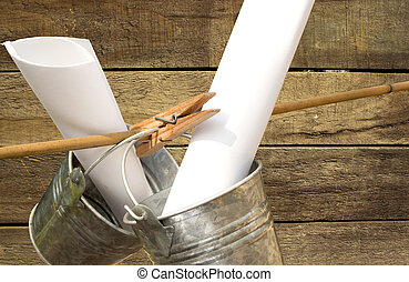 two galvanized buckets pegged on bamboo stick with wooden slatted background