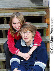 Two generations - Granddaughter and grandmother on the deck ...