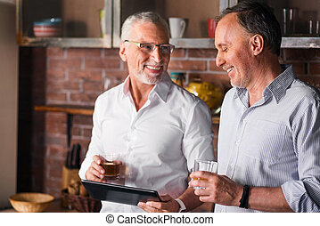 Two gentlemen having a little party with alcohol