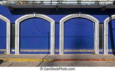 Two Giant Blue Doors with White Trim