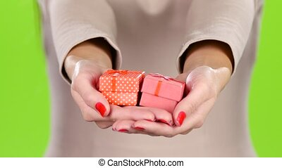 Two gift box in the hands of women. Close up