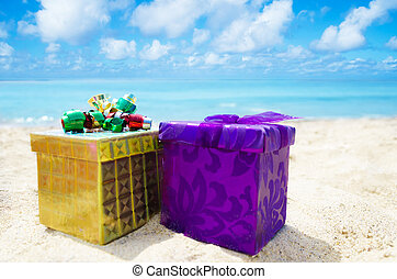 Two gift boxes on the beach - holiday concept